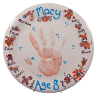 Child's hand print on plate